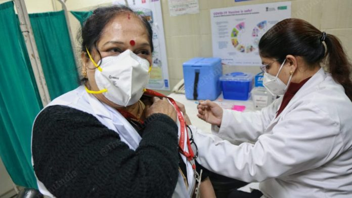 People getting  vaccine doses