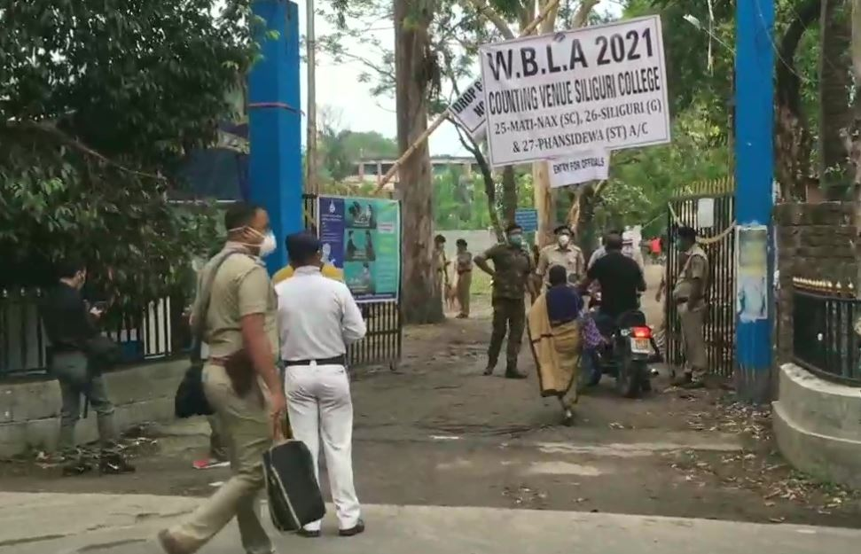 Officials, counting agents and others arrive at a counting centre at Siliguri College in Siliguri