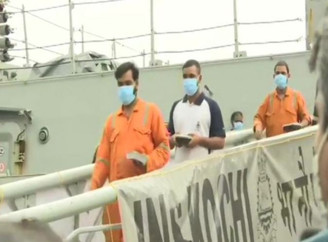 Rescued crew walks out of INS Kochi in Mumbai
