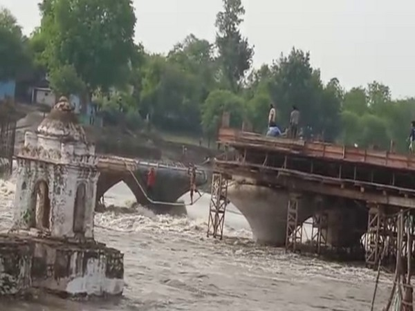 SDRF rescuing people after water level rose in the river in Sagar.