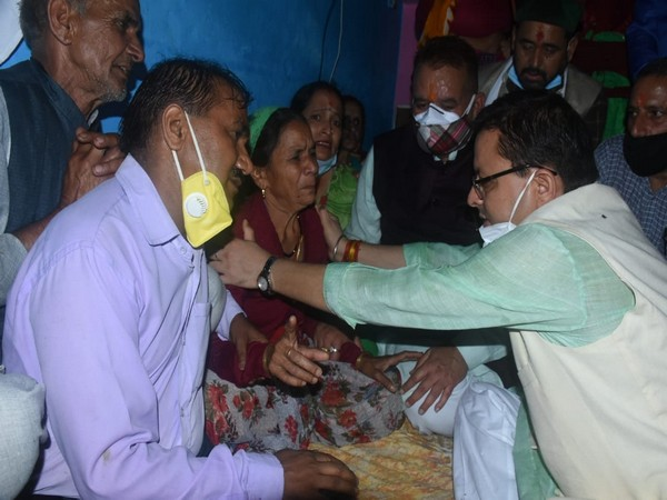 Uttarakhand Chief Minister Pushkar Singh Dhami meeting families of the people who died following a cloudburst.