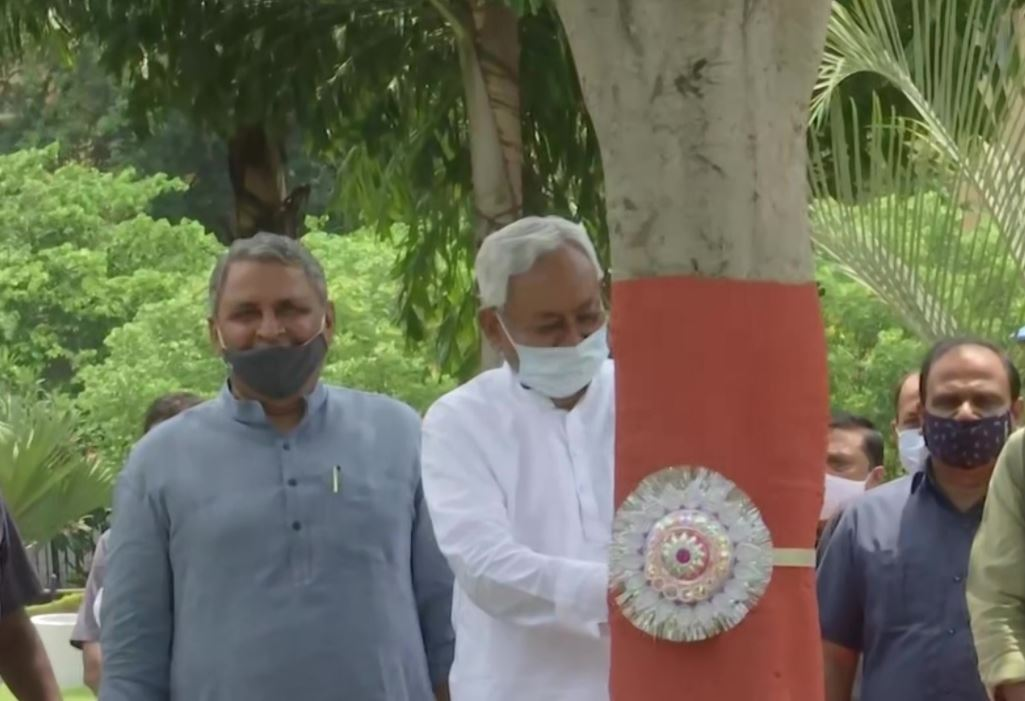 Bihar CM Nitish Kumar ties rakhis to trees